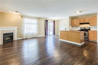 Photo 5: 23 TUSCARORA Way NW in Calgary: Tuscany House for sale : MLS®# C4174470