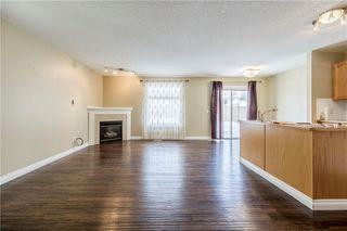 Photo 4: 23 TUSCARORA Way NW in Calgary: Tuscany House for sale : MLS®# C4174470