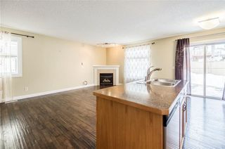 Photo 9: 23 TUSCARORA Way NW in Calgary: Tuscany House for sale : MLS®# C4174470