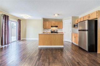 Photo 8: 23 TUSCARORA Way NW in Calgary: Tuscany House for sale : MLS®# C4174470