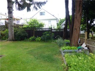Photo 8: 5325 MCKINNON Street in Vancouver: Collingwood VE House for sale (Vancouver East)  : MLS®# V1028861