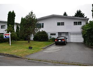 Photo 1: 3749 HAMILTON Street in Port Coquitlam: Lincoln Park PQ House for sale : MLS®# V1088203