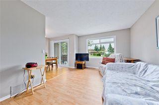 Photo 4: 66 14736 Deerfield Drive SE in Calgary: Deer Run House for sale : MLS®# C4123250