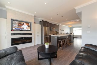 "Photo 2: 35 7090 180 Street in Surrey: Cloverdale BC Townhouse for sale in ""CROSSROADS"" (Cloverdale)  : MLS®# R2306037"