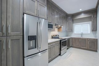 Photo 9: 7473 WILTSHIRE Drive in Surrey: East Newton House for sale : MLS®# R2319561