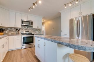 Photo 12: 204 FRONTENAC Avenue: Turner Valley Detached for sale : MLS®# A1033478