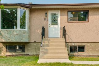 Photo 3: 204 FRONTENAC Avenue: Turner Valley Detached for sale : MLS®# A1033478