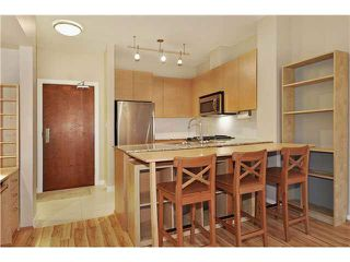 "Photo 4: 408 5775 IRMIN Street in Burnaby: Metrotown Condo for sale in ""MACPHERSON WALK"" (Burnaby South)  : MLS®# V1097253"