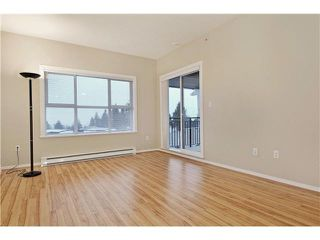 "Photo 2: 408 5775 IRMIN Street in Burnaby: Metrotown Condo for sale in ""MACPHERSON WALK"" (Burnaby South)  : MLS®# V1097253"