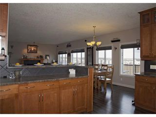 Photo 12: 108 WESTMOUNT Road: Okotoks House for sale : MLS®# C4046729