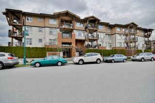 "Photo 1: 211 500 KLAHANIE Drive in Port Moody: Port Moody Centre Condo for sale in ""TIDES"" : MLS®# R2040671"