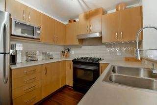 "Photo 3: 211 500 KLAHANIE Drive in Port Moody: Port Moody Centre Condo for sale in ""TIDES"" : MLS®# R2040671"