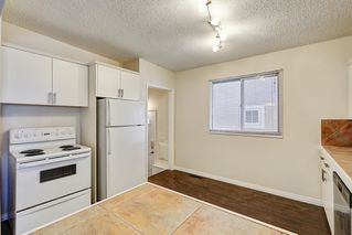 Photo 5: 3123 40 Street SW in Calgary: Attached for sale : MLS®# C4035349