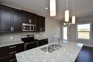 Photo 13: 52 Savanna Road NE in Calgary: Saddle Ridge House for sale : MLS®# C4119489