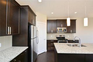 Photo 7: 52 Savanna Road NE in Calgary: Saddle Ridge House for sale : MLS®# C4119489