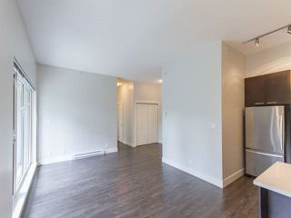 "Photo 14: 501 2362 WHYTE Avenue in Port Coquitlam: Central Pt Coquitlam Condo for sale in ""AQUILA"" : MLS®# R2179817"