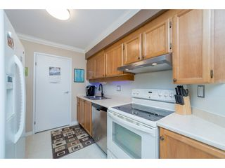 "Photo 6: 404 13876 102 Avenue in Surrey: Whalley Condo for sale in ""Glenwood Village"" (North Surrey)  : MLS®# R2202605"