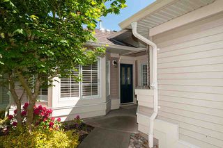 """Photo 1: 23 16888 80 Avenue in Surrey: Fleetwood Tynehead Townhouse for sale in """"STONECROFT"""" : MLS®# R2371189"""