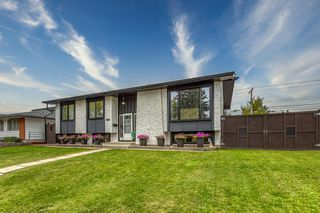 Photo 2: 1103 LAKE BONAVISTA Drive SE in Calgary: Lake Bonavista Detached for sale : MLS®# A1033227