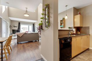 Photo 3: 1409 604 East Lake Boulevard NE: Airdrie Apartment for sale : MLS®# A1057063