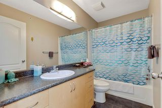 Photo 10: 1409 604 East Lake Boulevard NE: Airdrie Apartment for sale : MLS®# A1057063