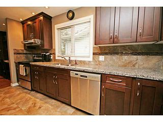Photo 7: 1151 LAKE WAPTA Road SE in Calgary: Lake Bonavista Residential Detached Single Family for sale : MLS®# C3637144