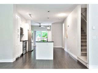 "Photo 8: 21 13864 HYLAND Road in Surrey: East Newton Townhouse for sale in ""TEO"" : MLS®# F1450968"