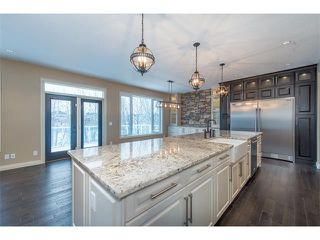 Photo 8: 22 ROCK LAKE View NW in Calgary: Rocky Ridge House for sale : MLS®# C4090662