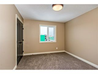 Photo 22: 22 ROCK LAKE View NW in Calgary: Rocky Ridge House for sale : MLS®# C4090662