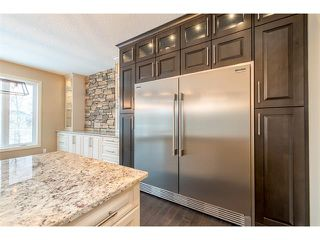 Photo 5: 22 ROCK LAKE View NW in Calgary: Rocky Ridge House for sale : MLS®# C4090662