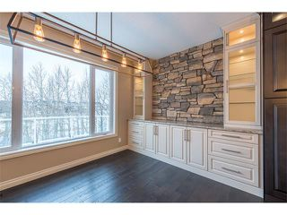 Photo 10: 22 ROCK LAKE View NW in Calgary: Rocky Ridge House for sale : MLS®# C4090662