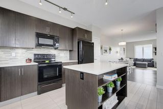 Photo 14: 102 WALDEN Circle SE in Calgary: Walden Row/Townhouse for sale : MLS®# C4236835