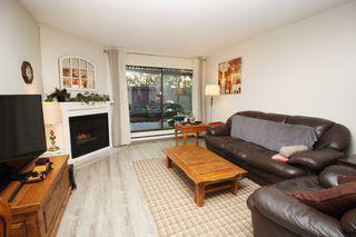 "Main Photo: 111 13507 96 Avenue in Surrey: Queen Mary Park Surrey Condo for sale in ""Parkwood"" : MLS®# R2355191"
