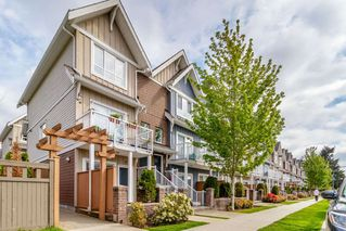 Photo 1: 410 1661 FRASER Avenue in Port Coquitlam: Glenwood PQ Townhouse for sale : MLS®# R2365928