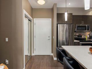 Photo 2: 309 22 AUBURN BAY Link SE in Calgary: Auburn Bay Apartment for sale : MLS®# A1032657