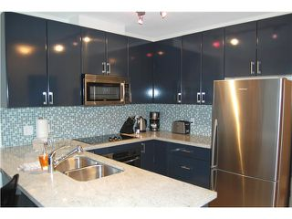 """Photo 1: 1602 1188 W PENDER Street in Vancouver: Coal Harbour Condo for sale in """"THE SAPPHIRE"""" (Vancouver West)  : MLS®# V1035875"""