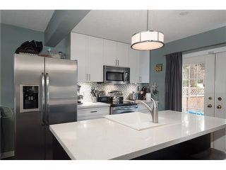 Photo 1: 214 BALMORAL Place in Port Moody: North Shore Pt Moody Townhouse for sale : MLS®# V1056784