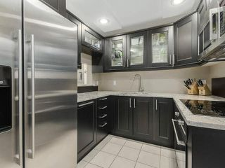 Photo 1: 201 1406 W 73RD Avenue in Vancouver: Marpole Condo for sale (Vancouver West)  : MLS®# V1111395