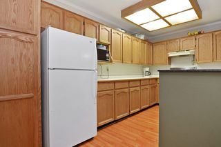 "Photo 7: 101 33030 GEORGE FERGUSON Way in Abbotsford: Central Abbotsford Condo for sale in ""Carlise"" : MLS®# F1446817"