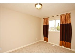 Photo 30: 8 EVERWILLOW Park SW in Calgary: Evergreen House for sale : MLS®# C4027806