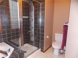 Photo 23: 120 SUNSET Close: Cochrane House for sale : MLS®# C4038629