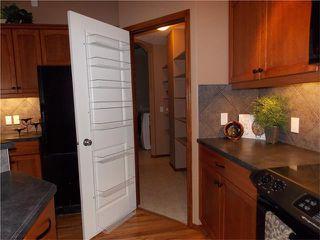 Photo 8: 120 SUNSET Close: Cochrane House for sale : MLS®# C4038629