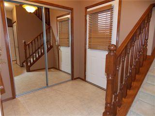 Photo 2: 120 SUNSET Close: Cochrane House for sale : MLS®# C4038629