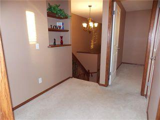 Photo 19: 120 SUNSET Close: Cochrane House for sale : MLS®# C4038629