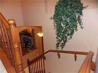 Photo 13: 120 SUNSET Close: Cochrane House for sale : MLS®# C4038629