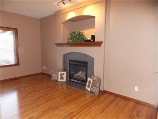 Photo 4: 120 SUNSET Close: Cochrane House for sale : MLS®# C4038629