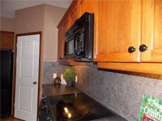 Photo 5: 120 SUNSET Close: Cochrane House for sale : MLS®# C4038629