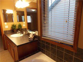 Photo 21: 120 SUNSET Close: Cochrane House for sale : MLS®# C4038629
