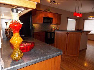 Photo 7: 120 SUNSET Close: Cochrane House for sale : MLS®# C4038629
