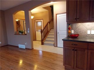 Photo 10: 120 SUNSET Close: Cochrane House for sale : MLS®# C4038629